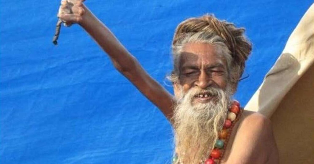 Indian Man Keeps His Arm Raised for over 48 Years